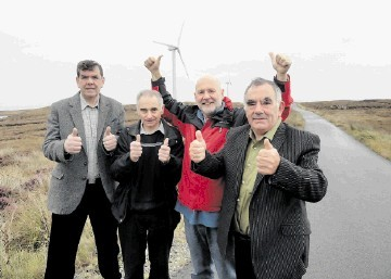 Donald John Macsween, second right, and other Point residents celebrate yesterday while visiting  other turbines