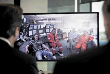 Prime Minister David Cameron talks to the crew of the Clair platform via video link during his visit to BP