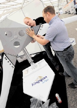 GETTING SET: Gavin Kerr and Tony Staniforth prepare their Kingspan Wind stand for All-Energy 2012. Colin Rennie