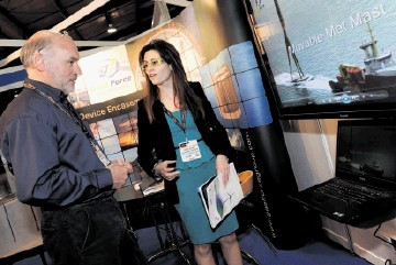 BRISK BUSINESS: Gael Force boss David Guthrie with Esther Villoria at his company's stand during the All-Energy show at the AECC. Colin Rennie