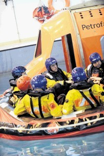 Offshore personnel undergoing safety training at Petrofac Training, Altens, Aberdeen