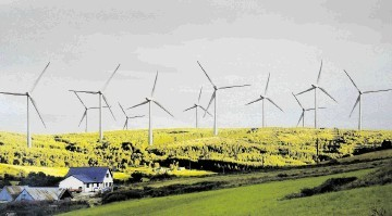 An impression of how the wind turbines would look beside the village