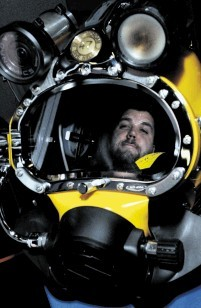 SUBSEA KIT: Dale Johnston, of Glasgow Caledonian University with a Kirby Morgan dive helmet