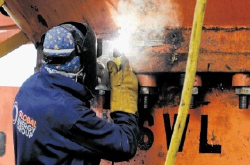 HOPE FOR THE FUTURE: Global Energy Group welder at the Nigg yard