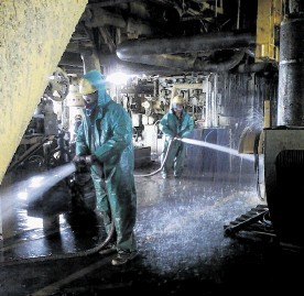 ENVIRONMENTAL ISSUES: Cleaning operations being conducted on the Elgin wellhead platform last year