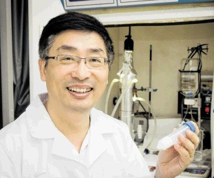 REMARKABLE: Prof Darren Sun of NTU, Singapore, with a sample of a  titanium dioxide nano-technology product