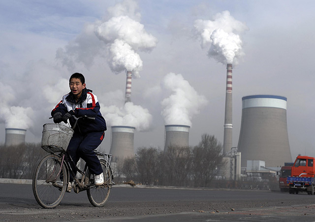 Cooling towers of a coal-fired power plant in Dadong, Shanxi province, China