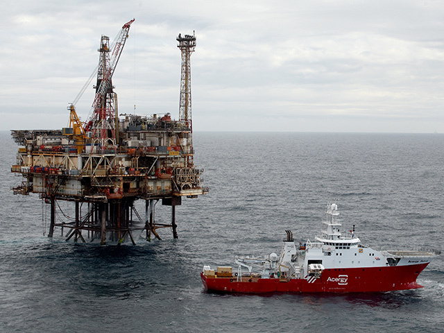 The Acergy Petrel alongside the Forties Bravo platform undertaking pipeline survey and inspection works.