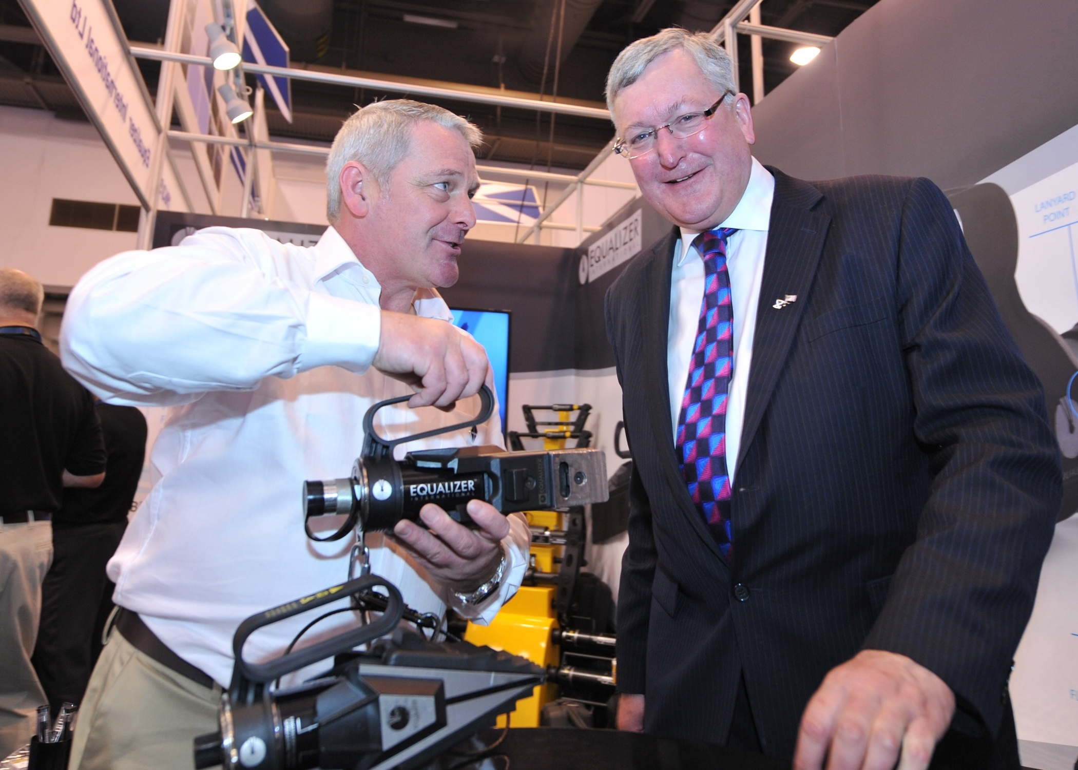 Bob Stephen, technical director with Equalizer International, shows off one of his company's tools to Scotland's Energy Minister Fergus Ewing at OTC. Picture by Barchfeld Photography.