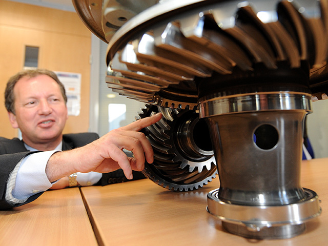 Former Eurocopter CEO Dr Lutz Bertliung with an EC225 shaft and gear box connection.