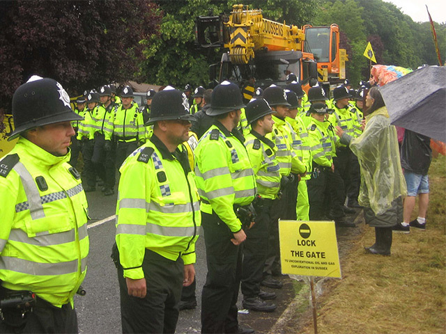 Police protect fracking site vehicles from protesters