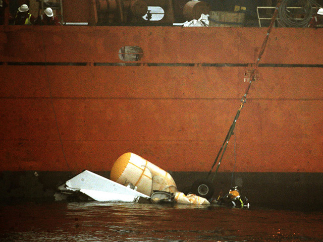 A diver works on the wreckage of the Super Puma L2 helicopter
