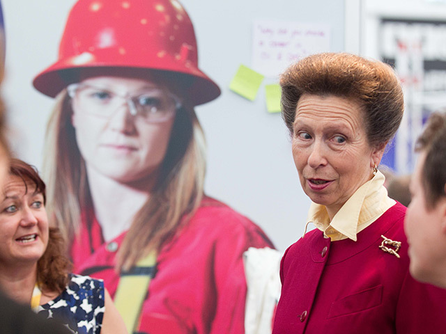 Princess Anne discusses oil and gas industry concerns with women at the Wise stand.