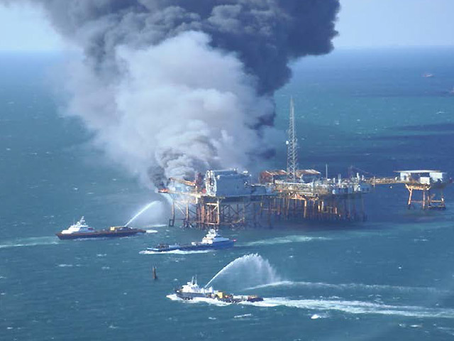 Firefighting vessels tackle the blaze on Black Elk's West Delta platform. Picture: US Coast Guard