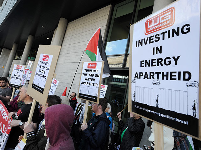 Scottish Palestine Solidarity Campaign (SPSC) protested at  Wood   Group 's AGM about the ongoing complicity in Israel's occupation and dispossession of Palestinian.