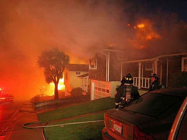 Firemen are seen outside burning homes after an explosion in  San   Bruno , Calif., Thursday, Sept. 9, 2010. Several homes were destroyed as a massive fire roared through a mostly residential neighbourhood in  San   Bruno .
