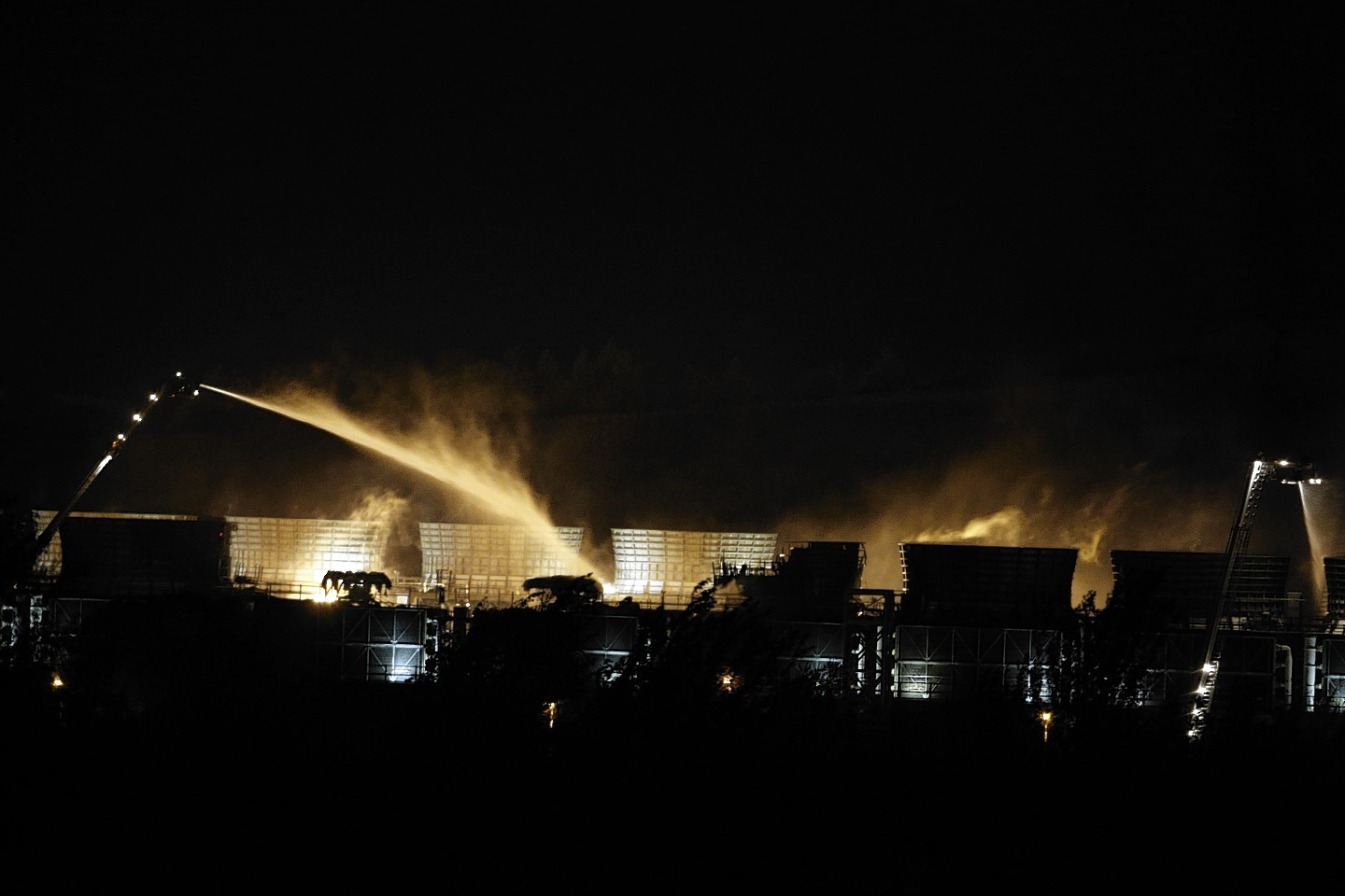Fire crews spray water at the scene of a fire at Didcot B Power Station in Oxfordshire.