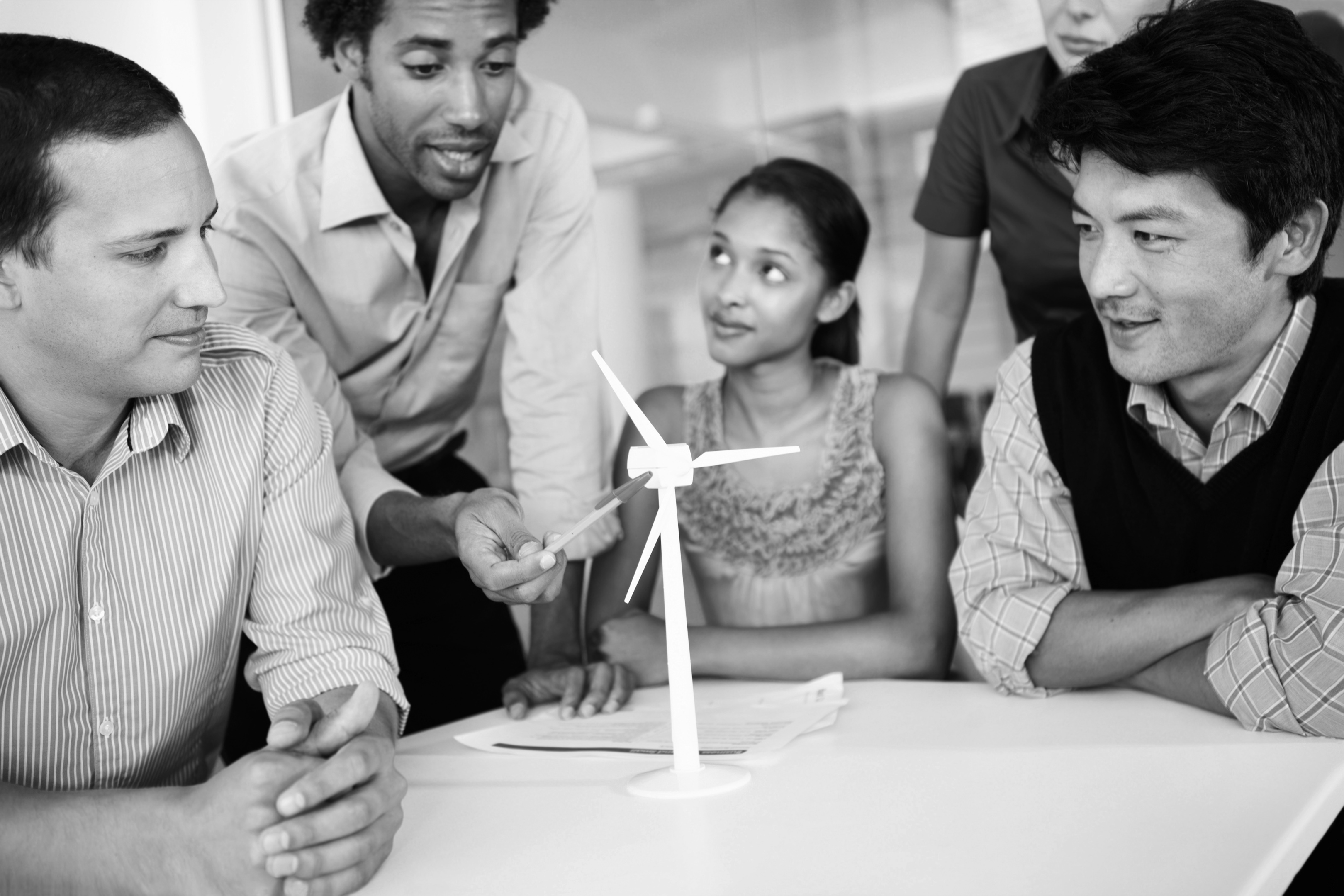 A team of engineers perfecting the design of their wind turbine