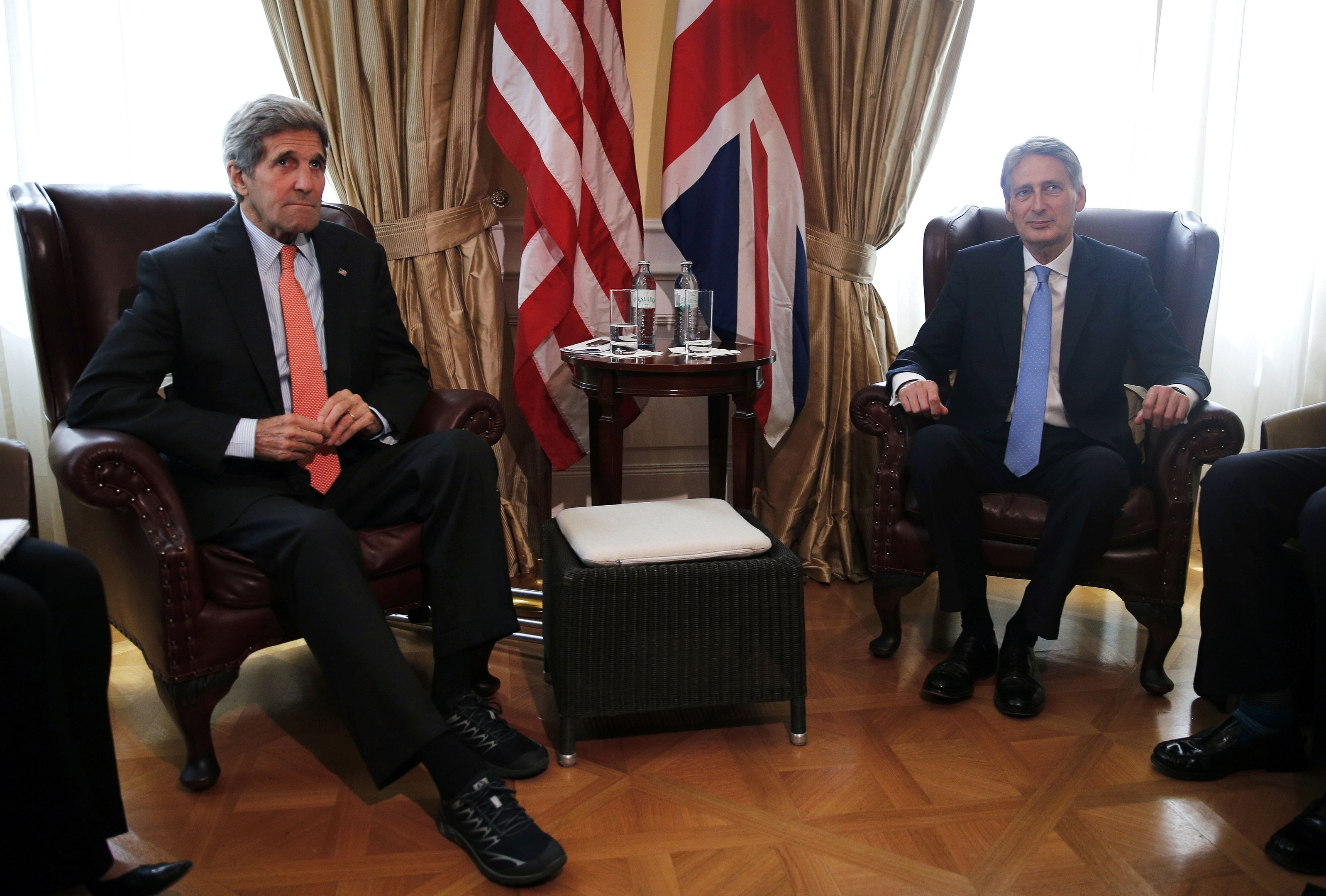 U.S. Secretary of State John Kerry, left, meets with British Foreign Secretary Philip Hammond at a hotel where the Iran nuclear talks meetings are being held in Vienna, Austria, Thursday, July 2, 2015