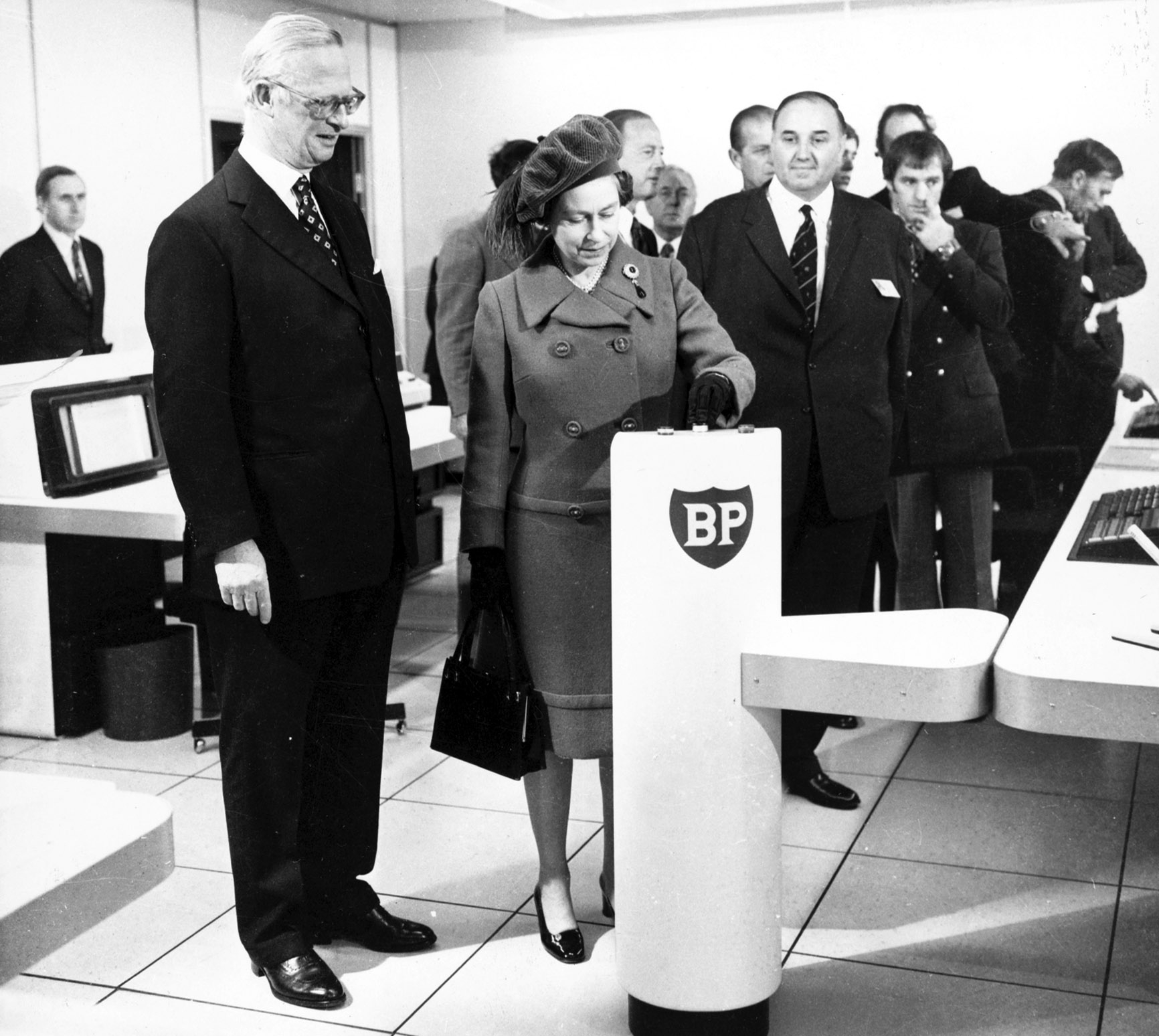 """The Queen at the """"switch-on""""  ceremony where she officially starts the oil flowing from the Forties Field at the BP complex in Dyce. Picture copyright Aberdeen Journals Ltd. 3rd November 1975"""