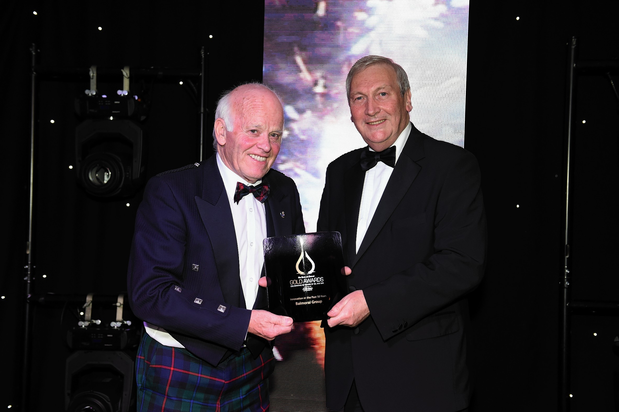 Jim Milne, chairman and managing director of Balmoral Group, being presented with an award by former Offshore Contractors Association chief executive Bill Murray at the 2015 Gold Awards.