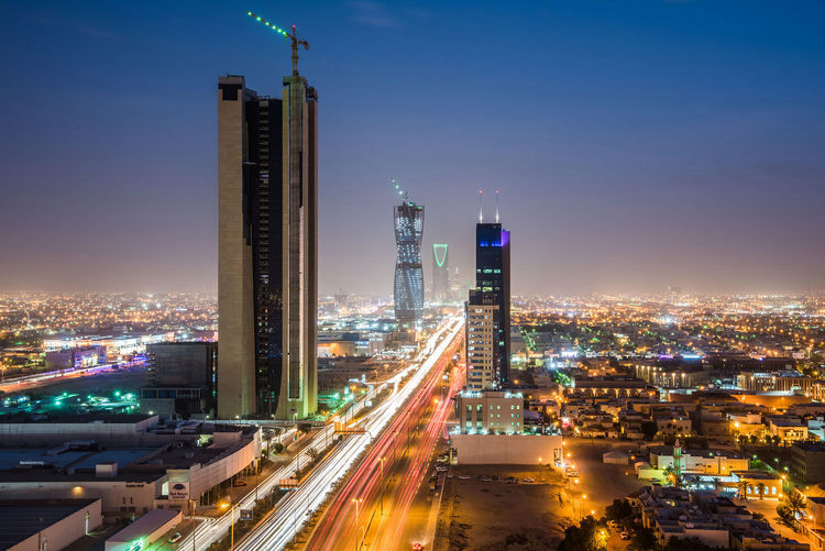 Light trails from traffic illuminate highways surrounded by residential buildings in Riyadh, Saudi Arabia