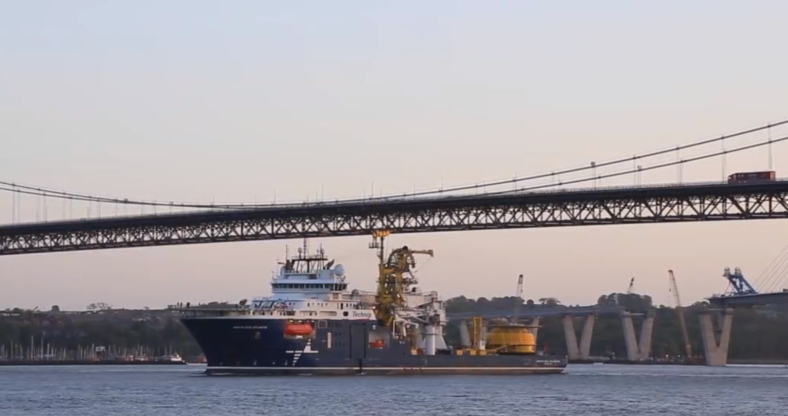 The North Sea Atlantic vessel passing below the Forth Road Bridge