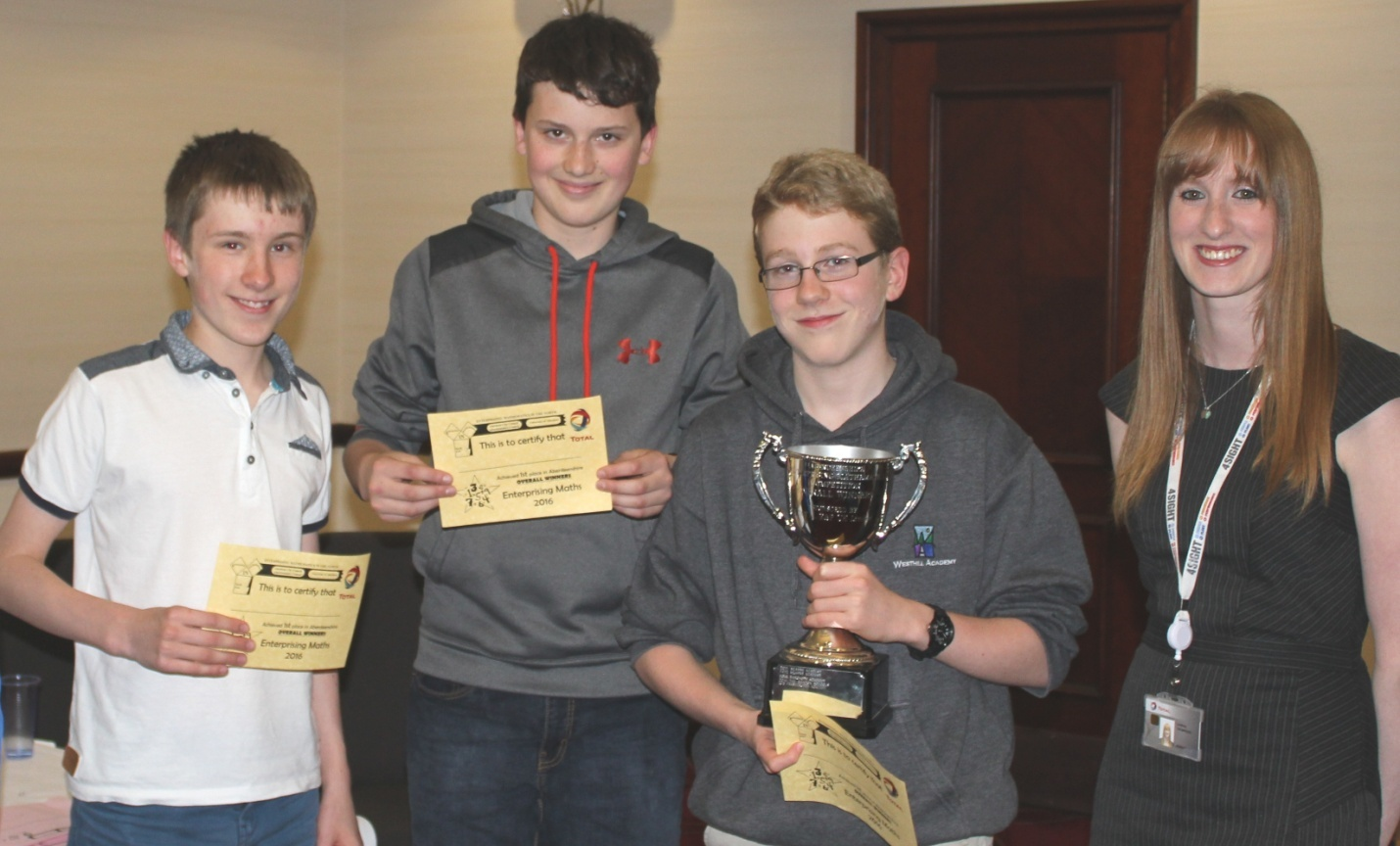 Westhill Academy winners (L-R) Ieuen Harries, Jacob Dohan and James Marriner with TEP UK Graduate Information Systems Analyst, Lindsey Thompson (far right).