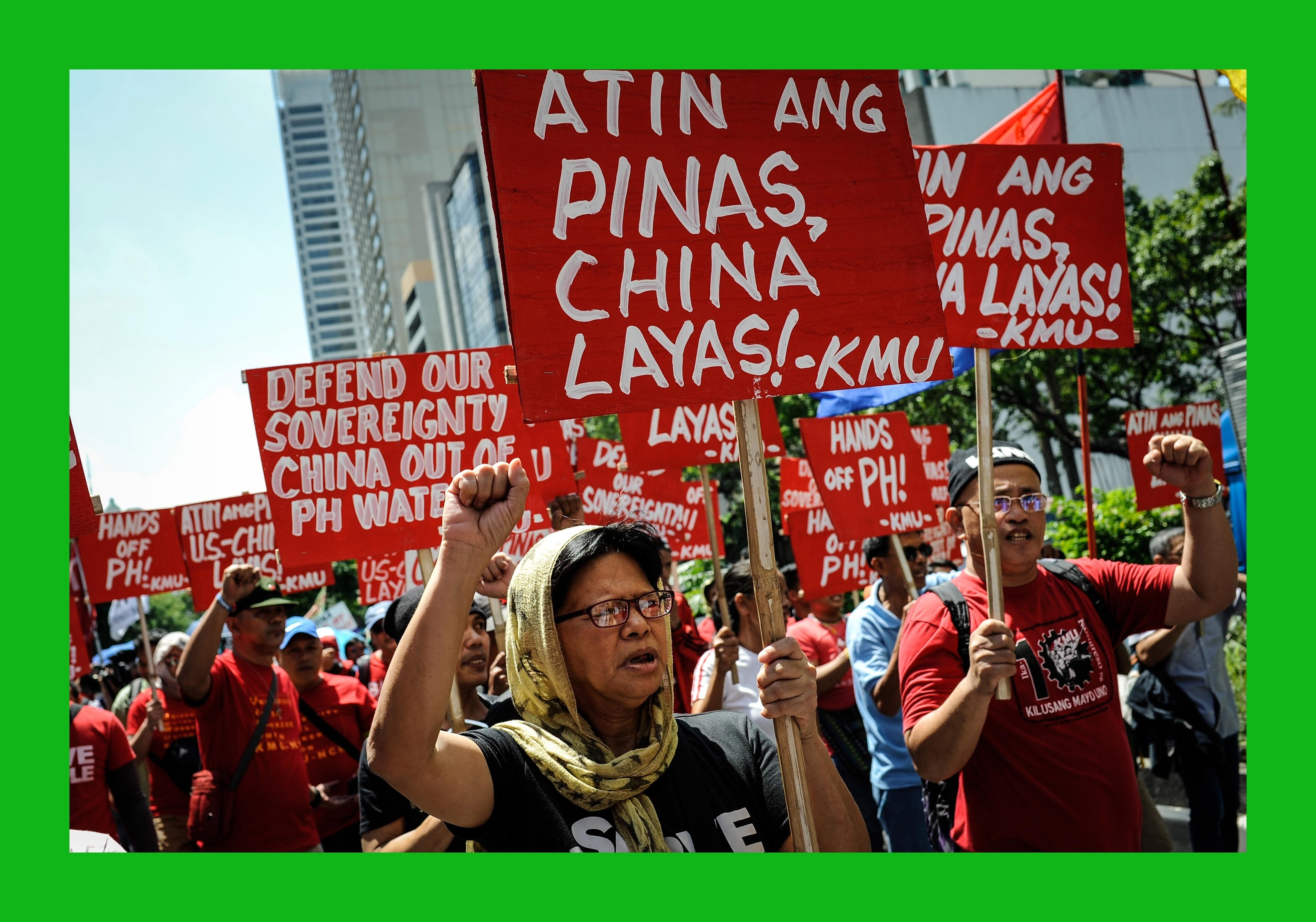 Anti China protesters mount a rally against China's territorial claims in the Spratlys group of islands in the South China Sea in front of the Chinese Consulate on July 12, 2016 in Makati, Philippines.