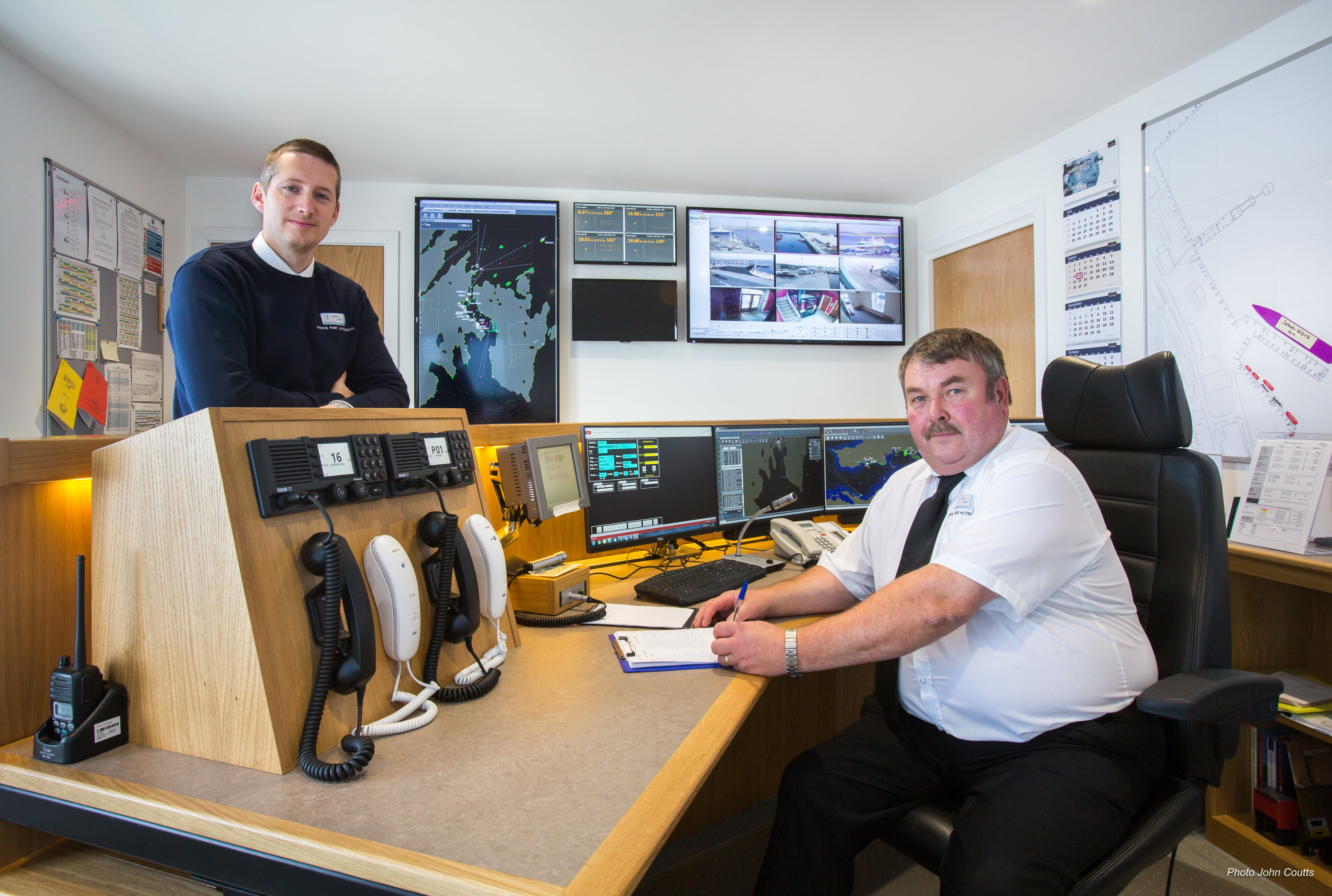 Lerwick Harbour's port control room and the newly installed Vessel Monitoring System, with Deputy Harbourmaster Alexander Simpson (left) and Port Controller Douglas Garrick. Photo courtesy of John Coutts.