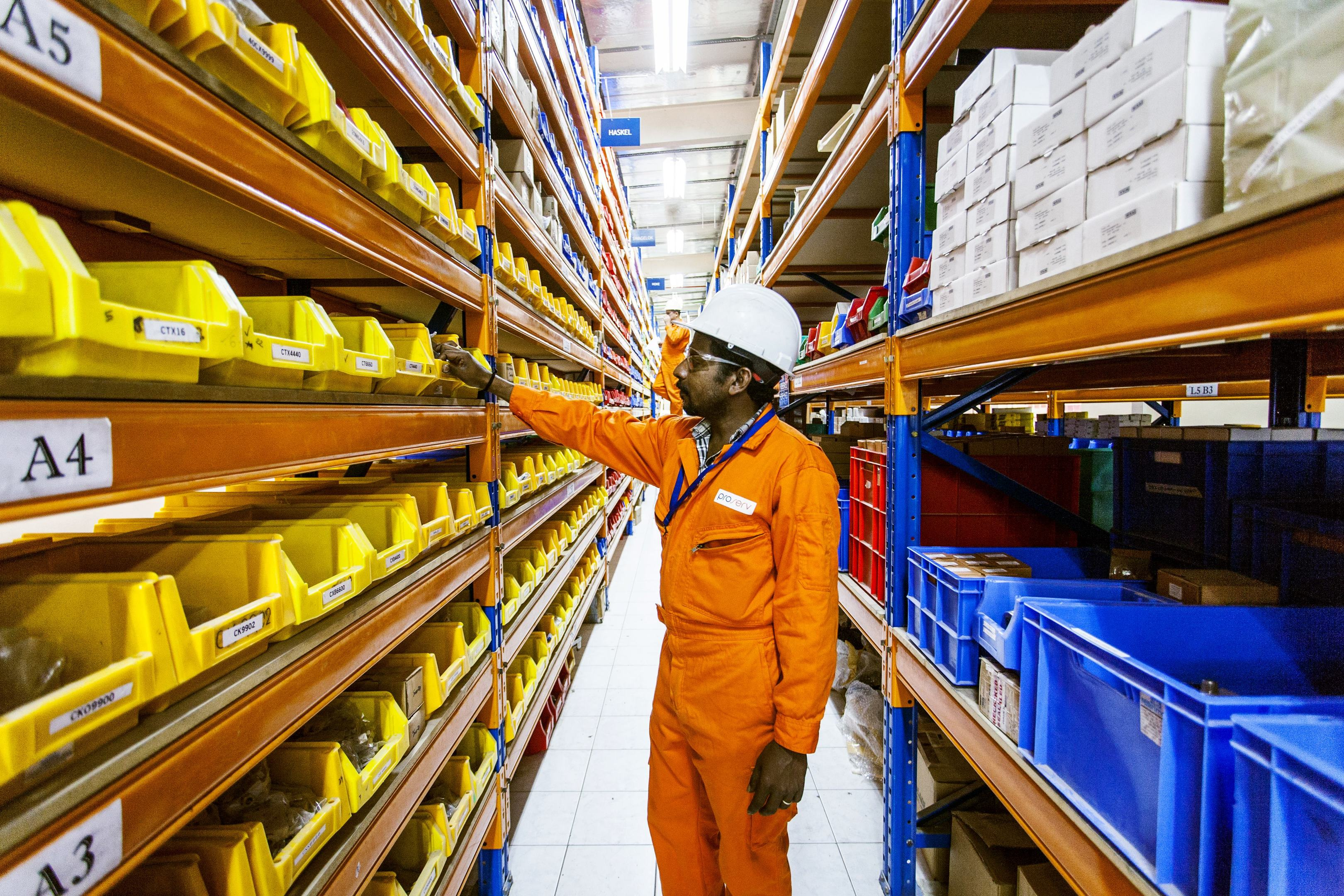 A Proserv employee in one of the firm's storerooms.