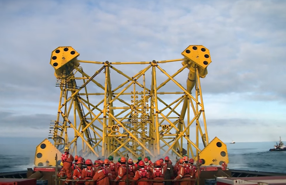 A steel support jacket being launched into the North Sea