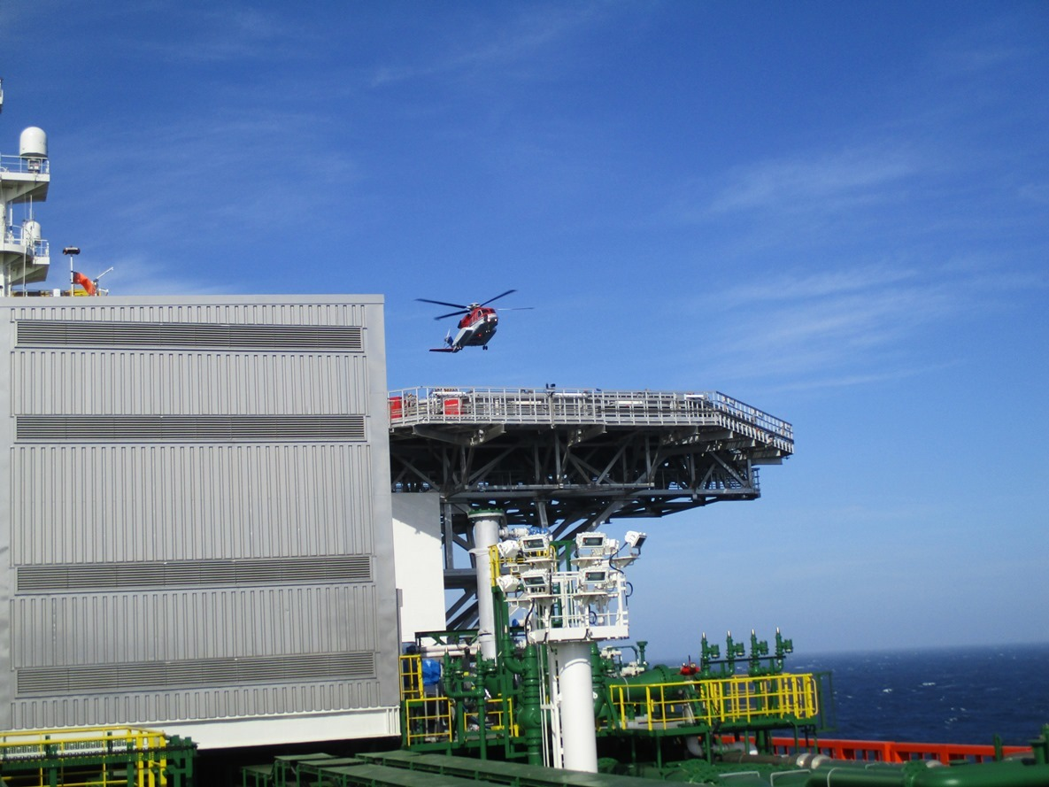 The helicopter arriving on the helideck