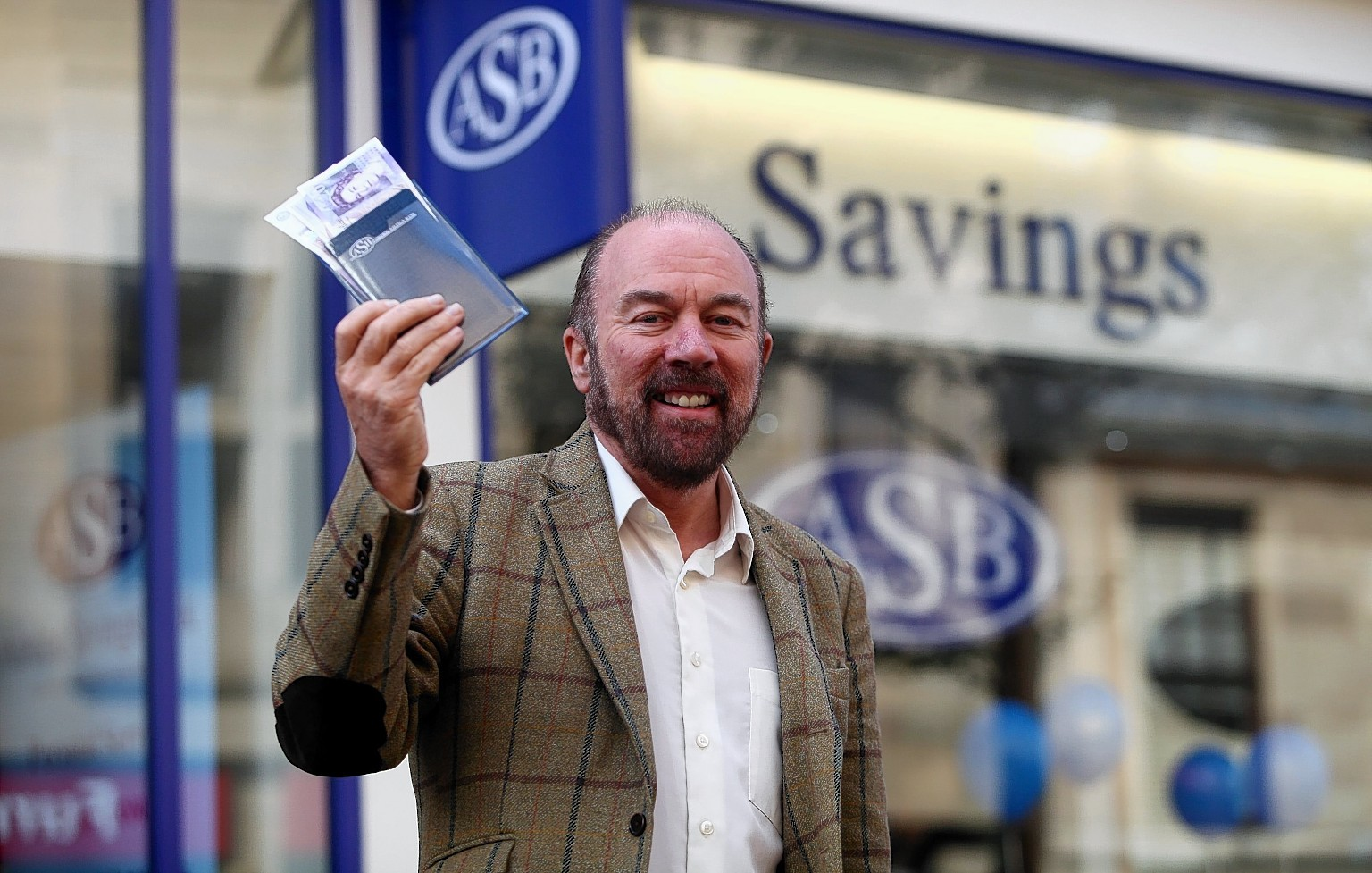 A file photo of Brian Souter opening the new Airdire Savings Bank in Falkirk, Stirlingshire.