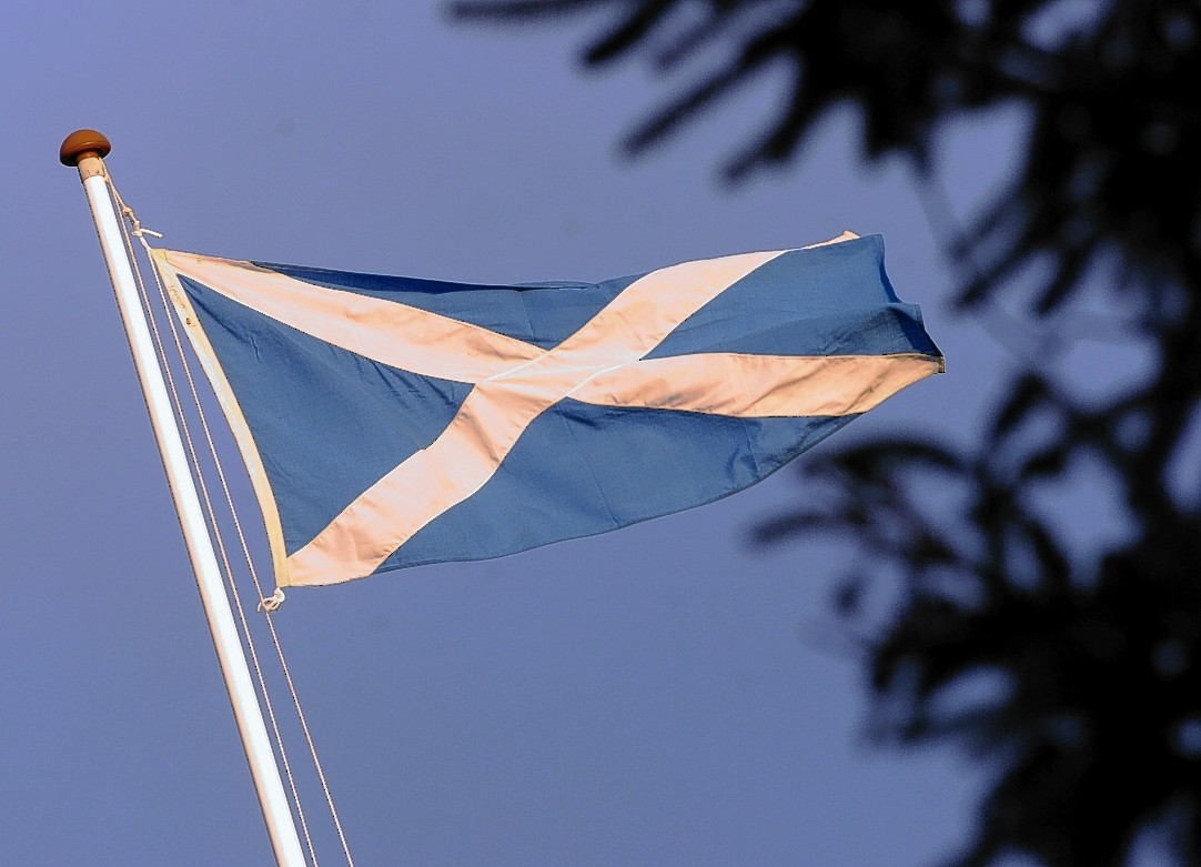 Saltire flying on the roof of Stonehaven Town Hall. Picture by KEVIN EMSLIE          .
