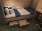 A bed inside an offshore accommodation module's cabin.