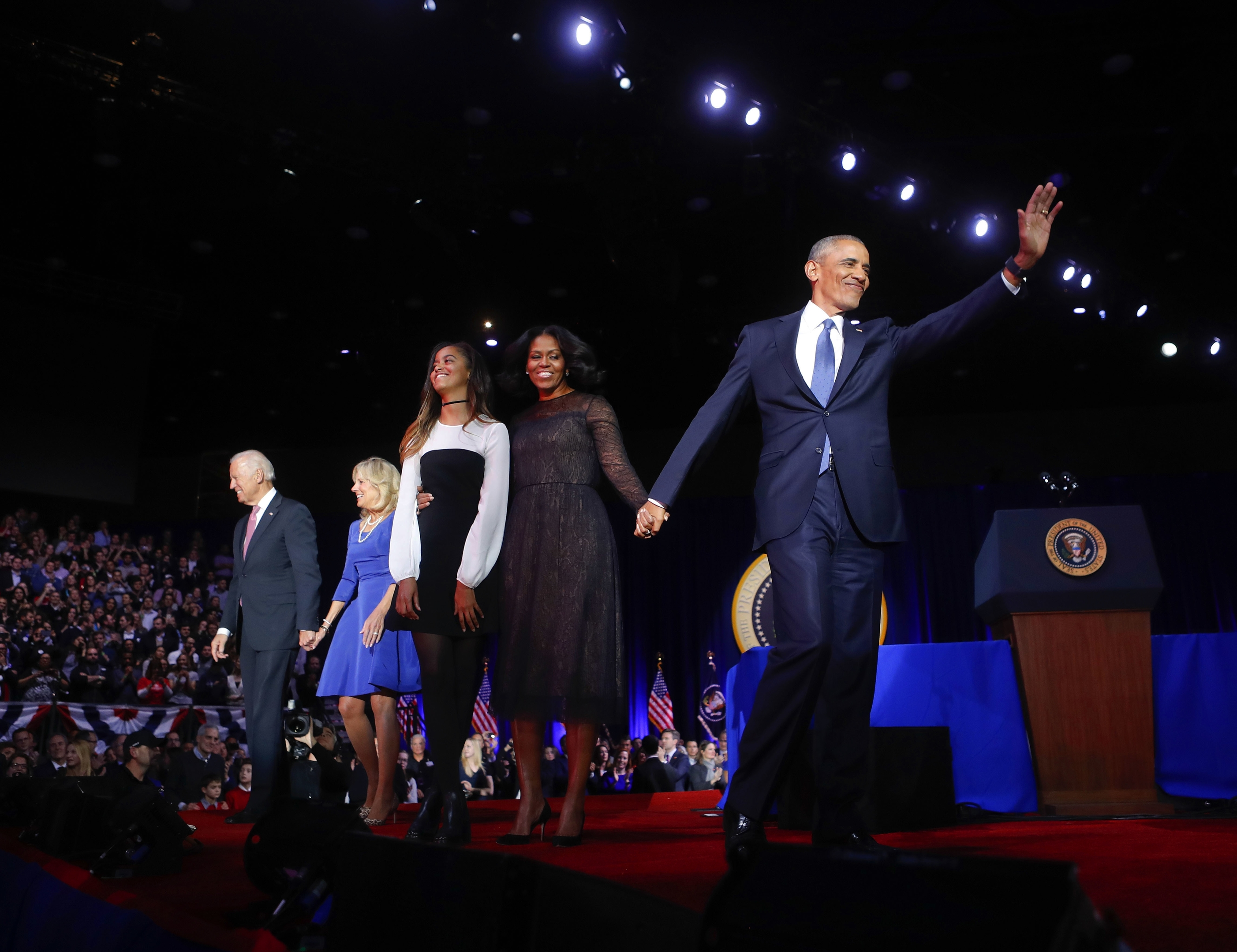 President Barack Obama waves on stage with first lady Michelle Obama, daughter Malia, Vice President Joe Biden and his wife Jill Biden after his farewell address at McCormick Place in Chicago