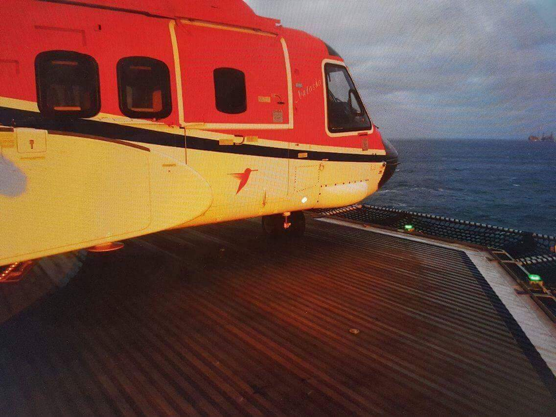 A picture showing the proximity of the helicopter's nose to the edge of the deck.