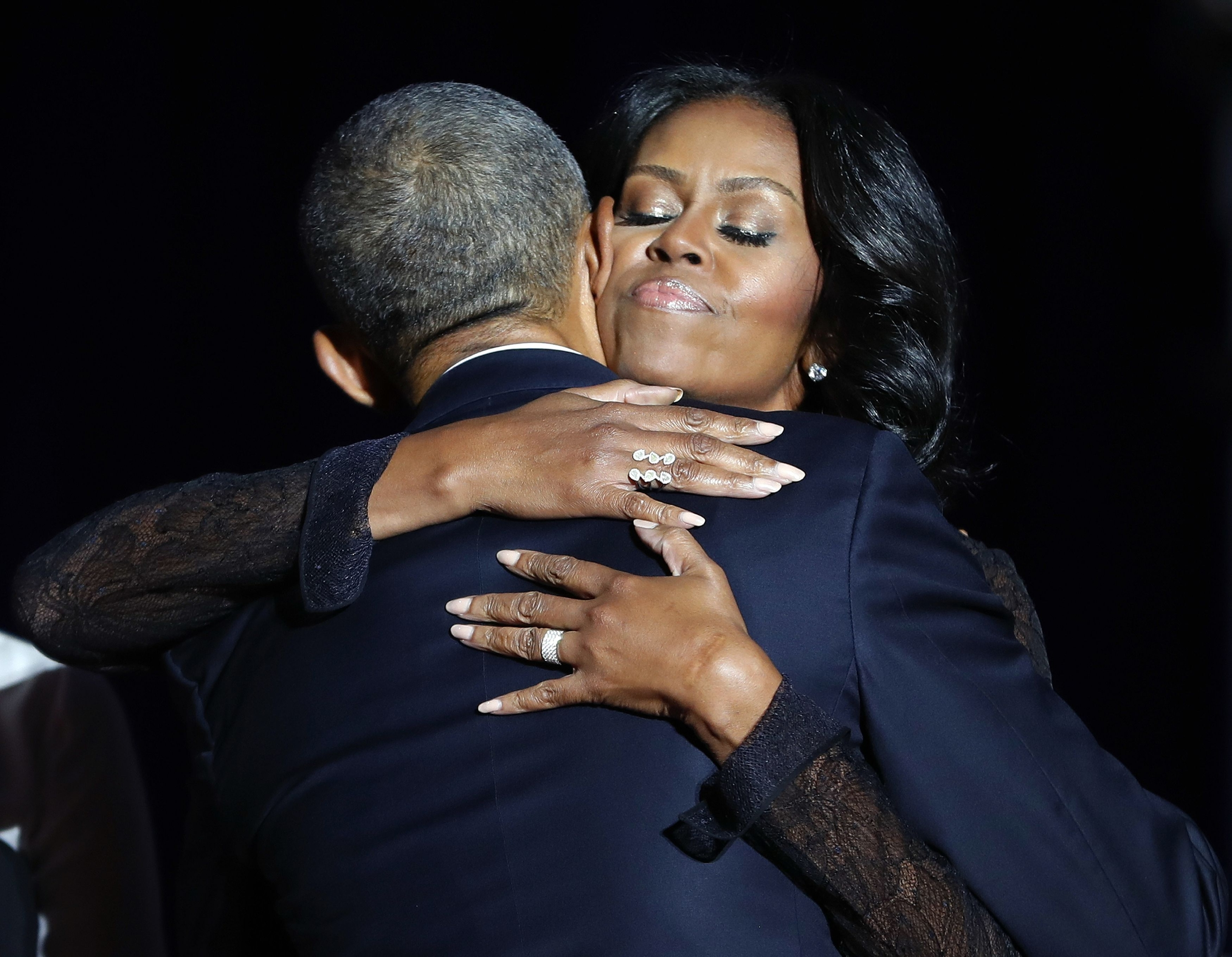 First lady Michelle Obama hugs President Barack Obama after his farewell address at McCormick Place in Chicago,