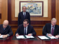 Claudio Descalzi, BP chief executive Bob Dudley, right, and Egyptian Petroleum Minister Tarek El Molla signing the deed in Cairo yesterday