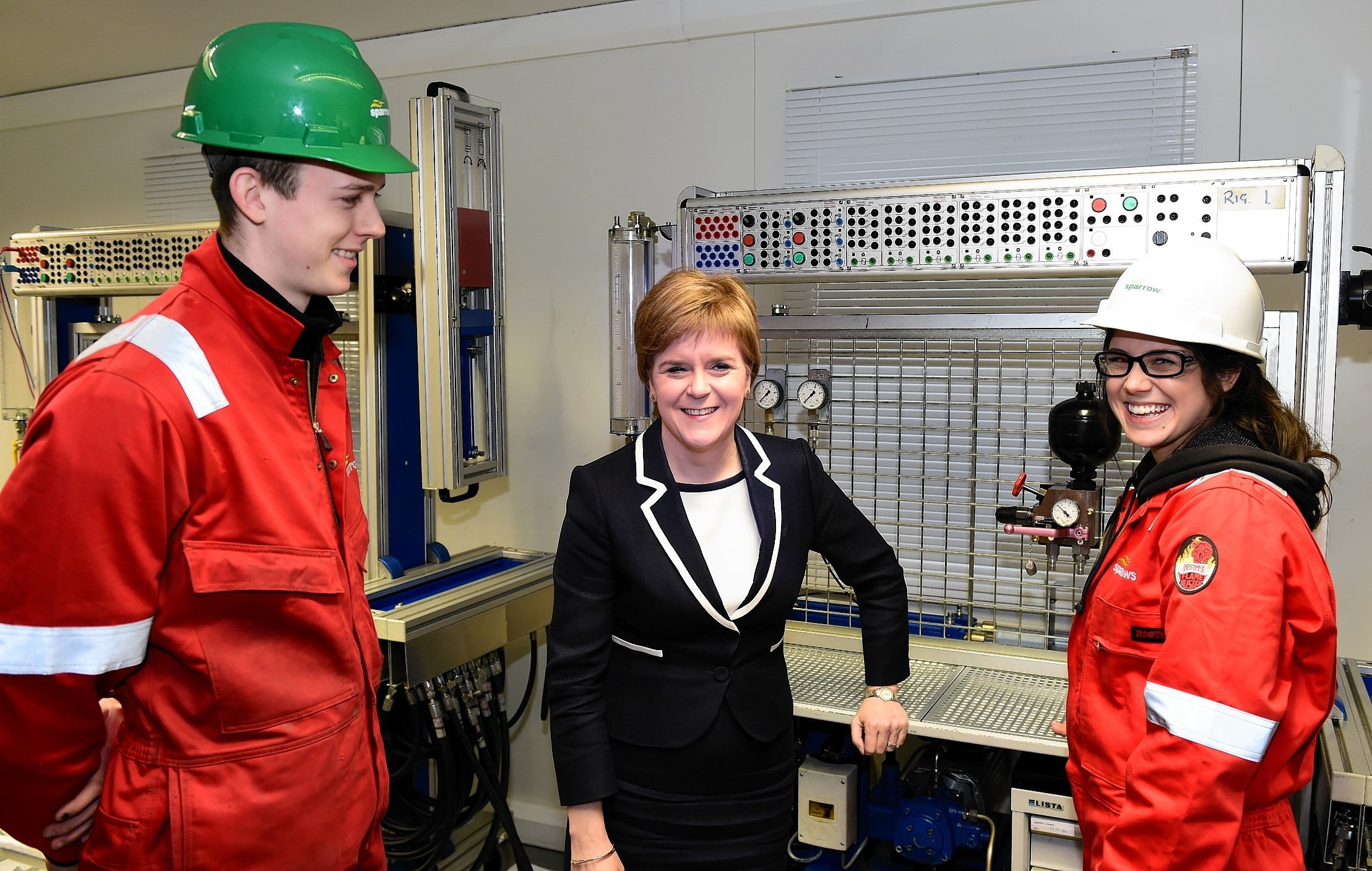 First Minister Nicola Sturgeon at Sparrows Training Centre, with apprentice's Leanne Brown and Adam Clark (left).