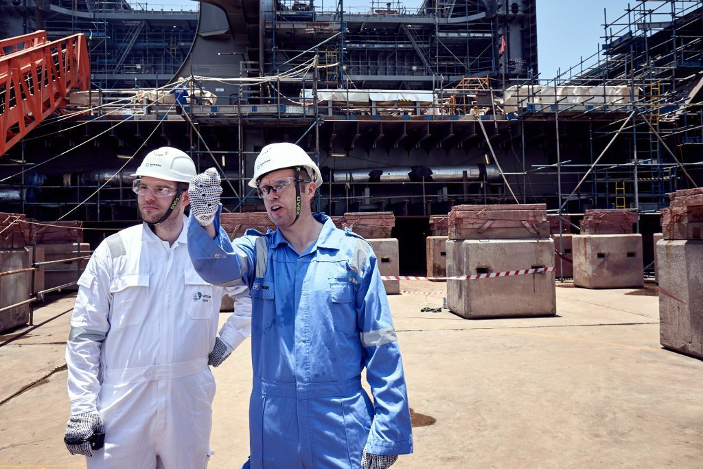 Mr McAuley, right, with Energy Voice's Mark Lammey at Sembcorp's Tuas yard.