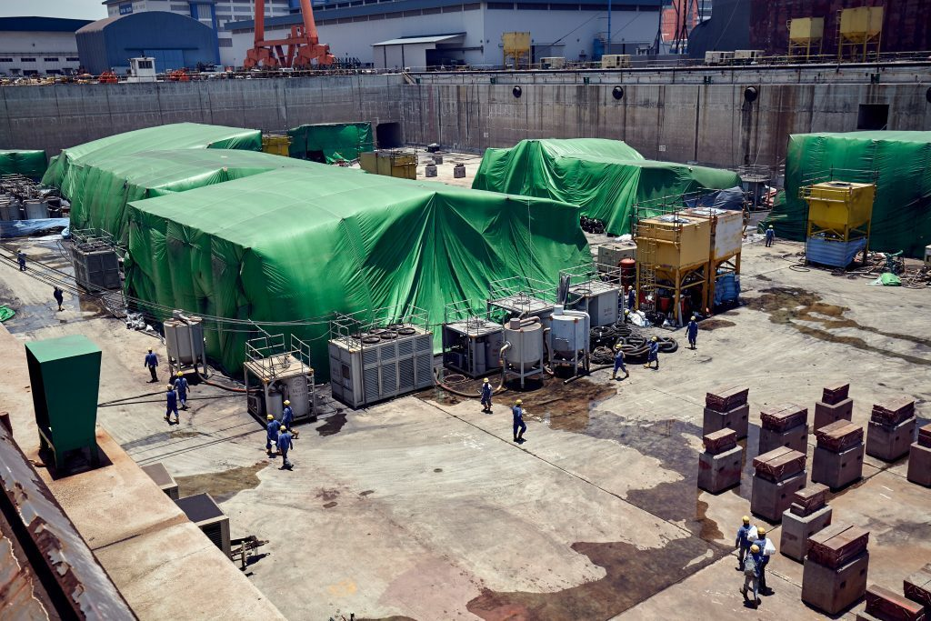 Under the green covers are sections of the FSO which have yet to be attached.