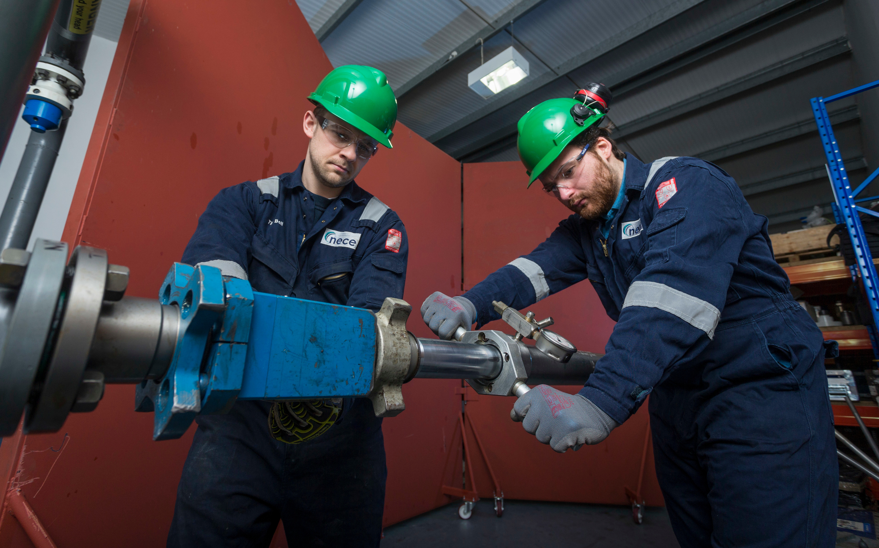 NECE - Tim Bell and David Clark installing a corrosion monitoring device