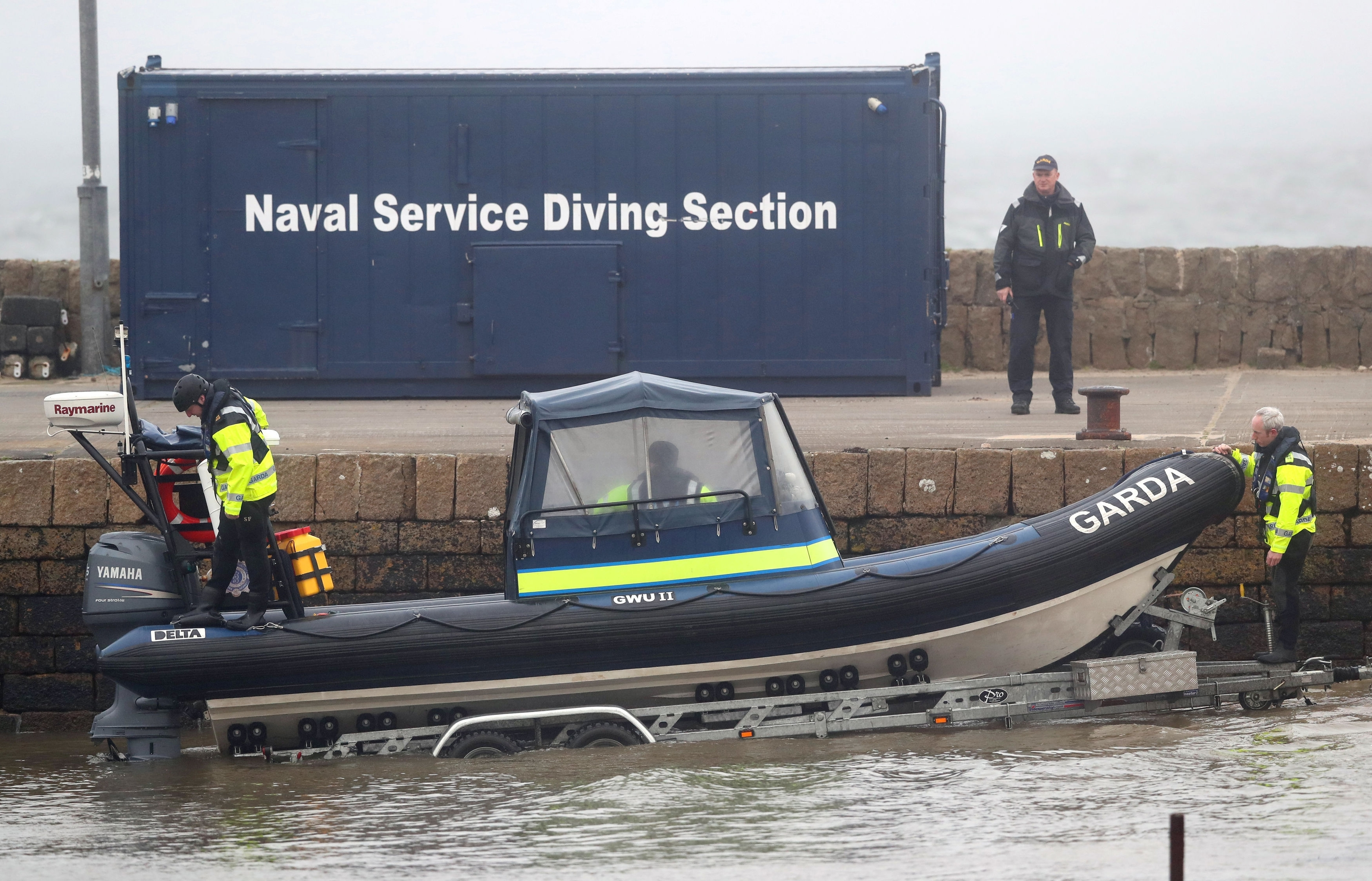 Garda water unit prepare to launch a rib in Blacksod, Co Mayo, as the search continues for an Irish Coast Guard helicopter which went missing off the west coast of Ireland in the early hours of the morning. Picture taken Wednesday