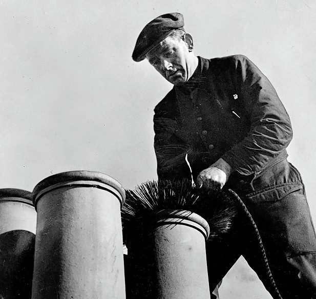 A file photo of a chimney sweep lowering a ball and brush down a chimney in Aberdeen in 1949.