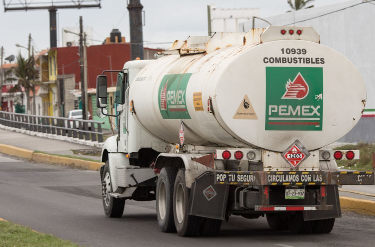 A Petroleos Mexicanos (Pemex) truck exits a supply center in Veracruz City, Mexico. Photographer: Brett Gundlock/Bloomberg