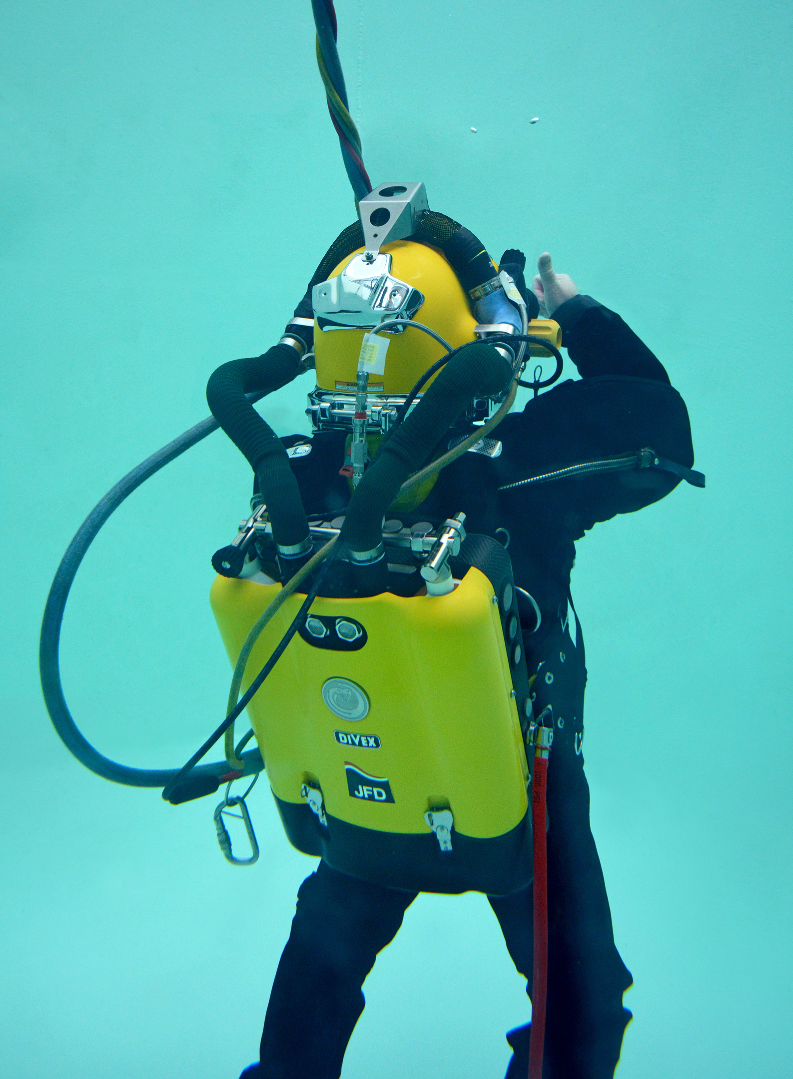 Diver in test tank performing trials on COBRA equipment