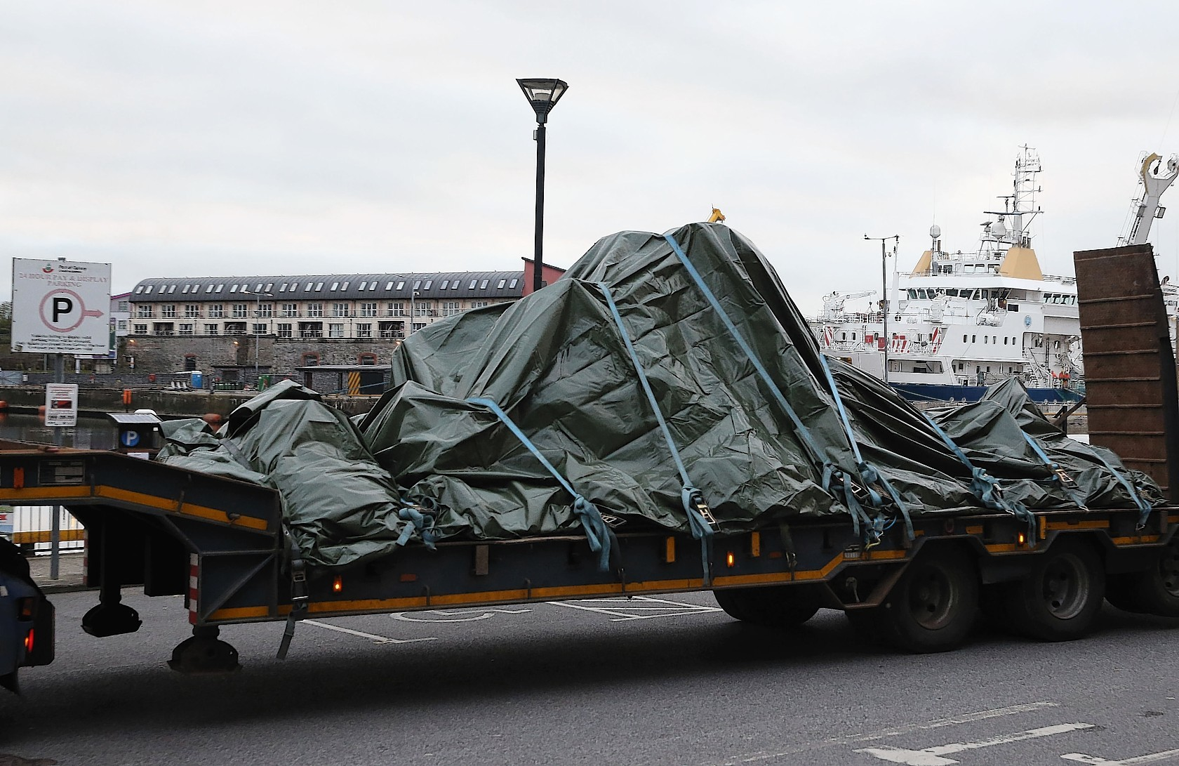 The wreckage of the Irish Coast Guard helicopter, callsign Rescue 116, which crashed off the west coast of Ireland on March 14, leaves Galway harbour on a flat bed truck after the aircraft was recovered from the seabed near Blackrock. Photo credit  Brian Lawless/PA Wire