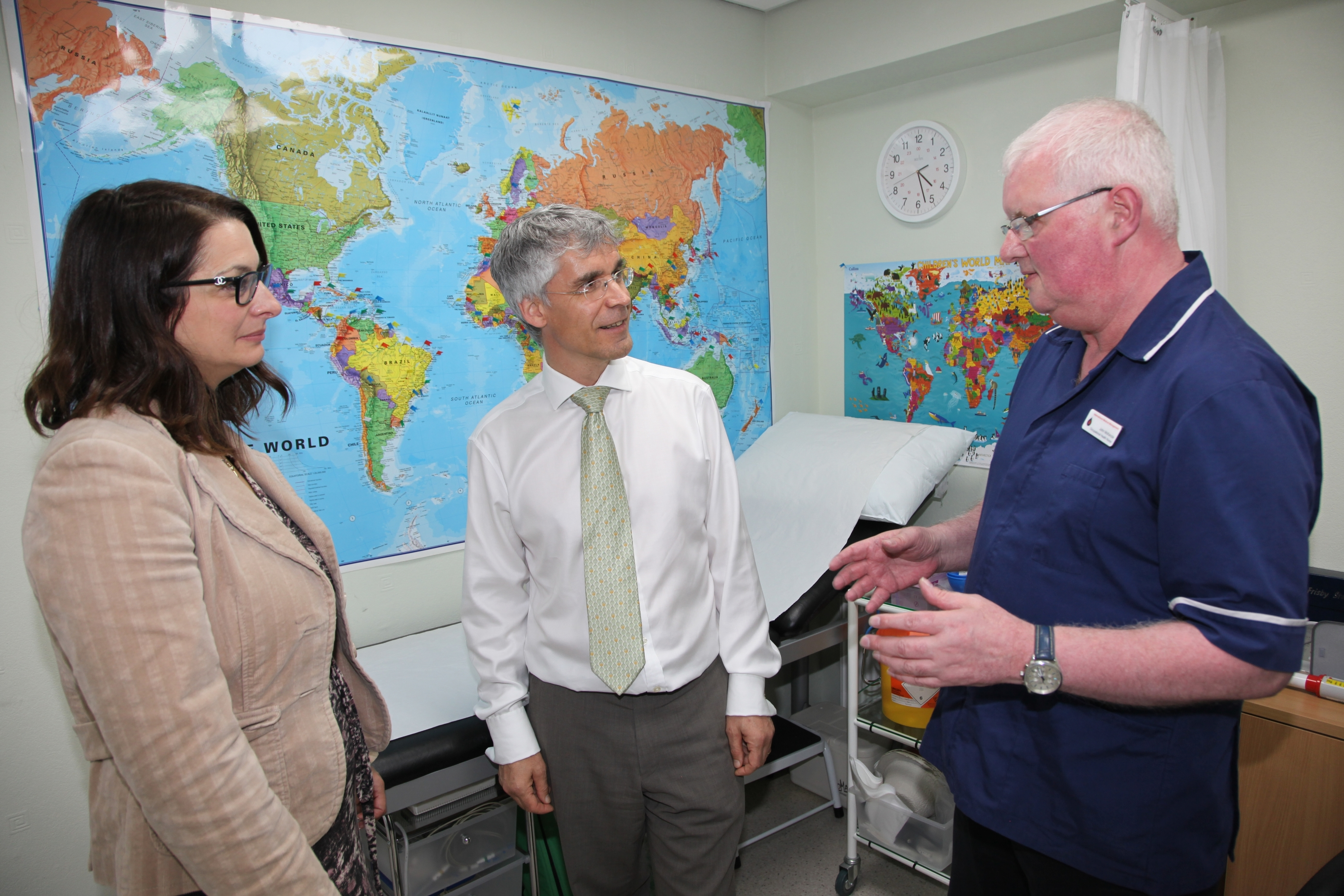 l-r Dr Oli Asatiani,, Dr Graham Furnace, and travel health and screening specialist John McKenzie, at IMM's Aberdeen clinic
